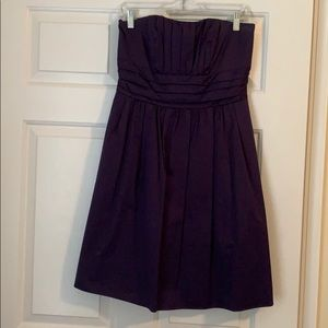 Davids Bridal Bridesmaids dress in plum.